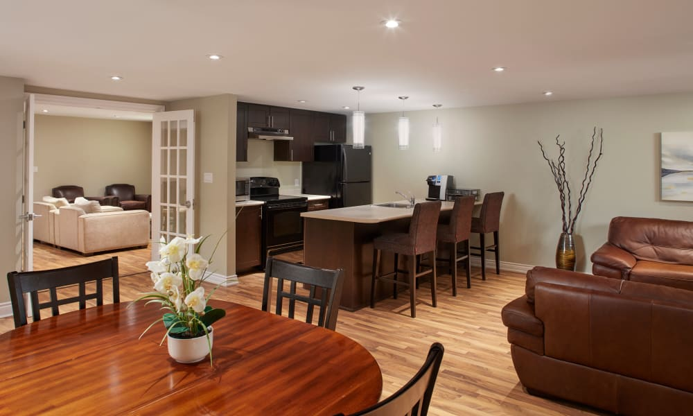 Open layout dinning room, living room, and kitchen at Bayview Mews in North York, Ontario