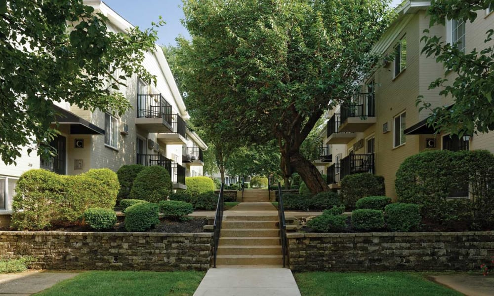 Walking path between apartments at Stonegate at Devon Apartments in Devon, Pennsylvania