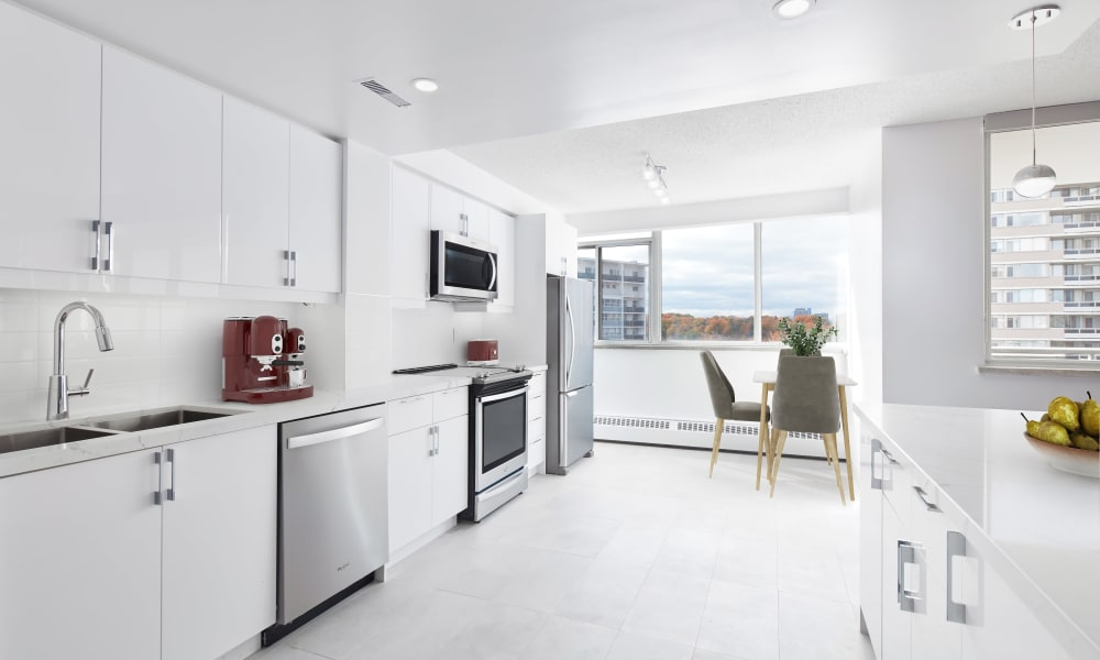 Bright kitchen with stainless steel appliances at Cloisters of the Don in North York, Ontario