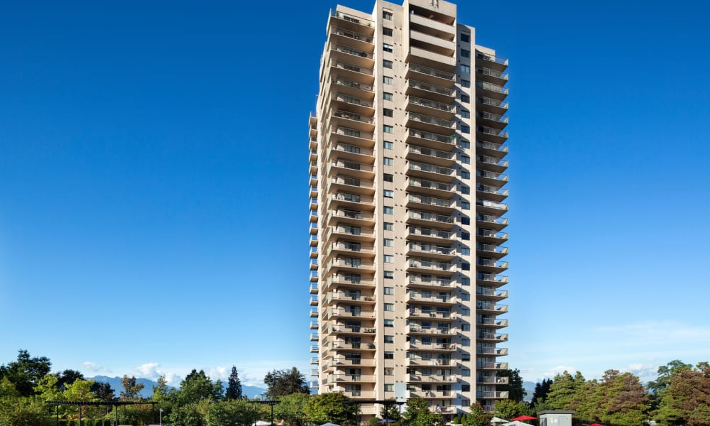 Exterior of Panarama Tower in front of the blue sky in Burnaby, British Columbia