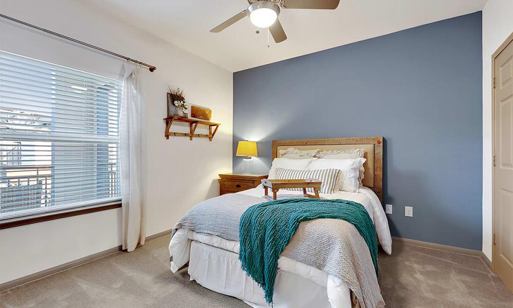 Spacious, modern bedroom at Plum Creek Vue in Kyle, TX