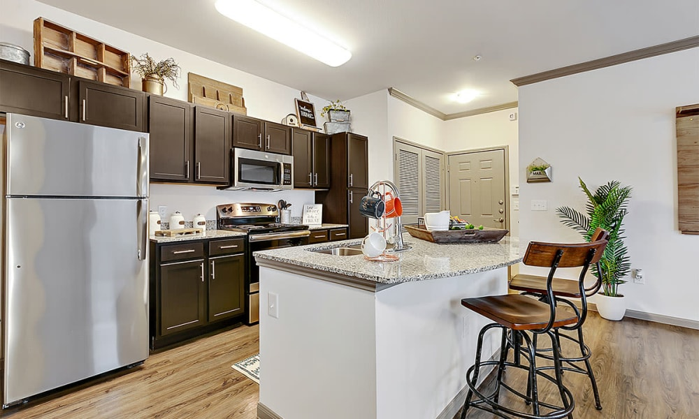 Open kitchen with island at Plum Creek Vue in Kyle, TX