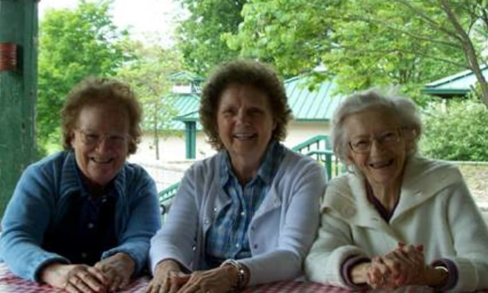 3 women sitting outside at Belle Reve Senior Living in Milford, Pennsylvania
