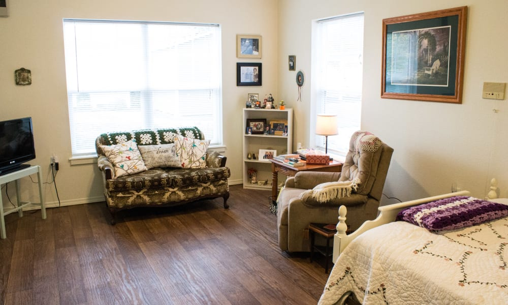 Independent living space with hardwood floors at Evergreen Memory Care in Eugene, Oregon
