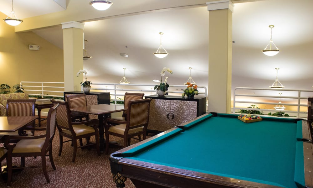 Game room with a billiards table at Woodside Senior Living in Springfield, Oregon