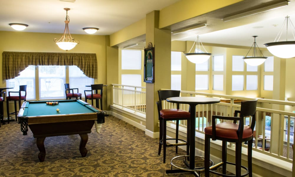 Upstairs game room with a billiards table at Timber Pointe Senior Living in Springfield, Oregon