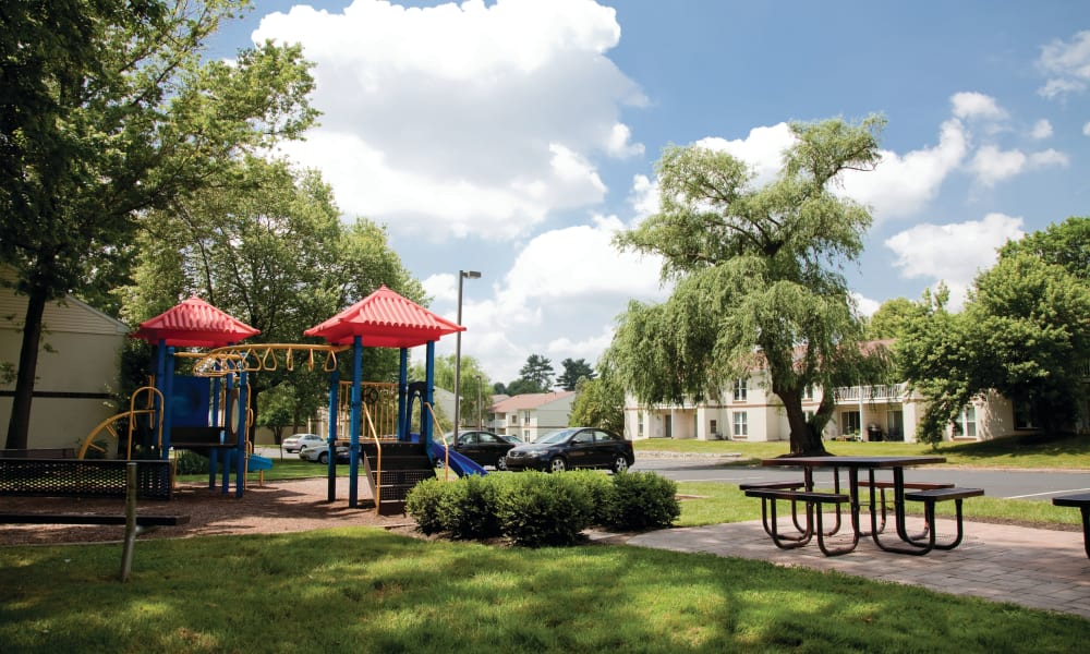 Play structure and seating area at Willowbrook Apartments in Jeffersonville, Pennsylvania