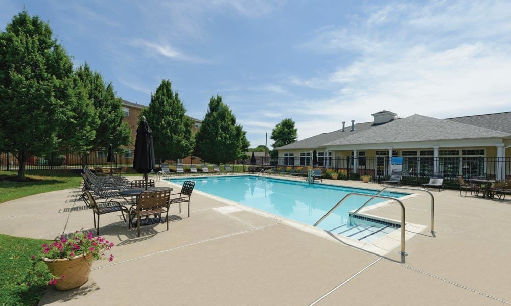 Resort-style swimming pool at Hill Brook Place Apartments in Bensalem, Pennsylvania