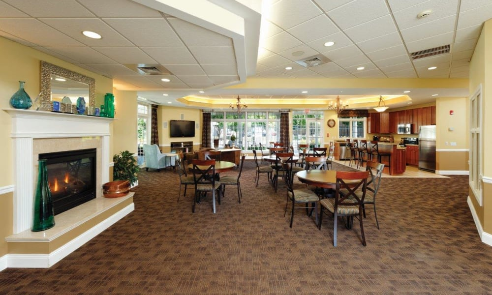 Community dining area with a fireplace at Hill Brook Place Apartments in Bensalem, Pennsylvania