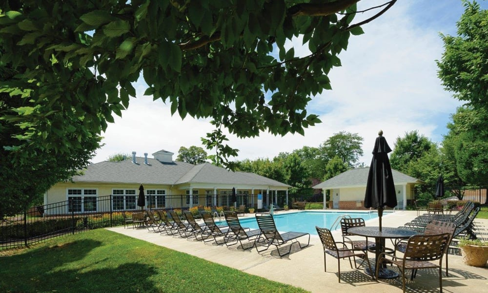 Poolside seating at Hill Brook Place Apartments in Bensalem, Pennsylvania