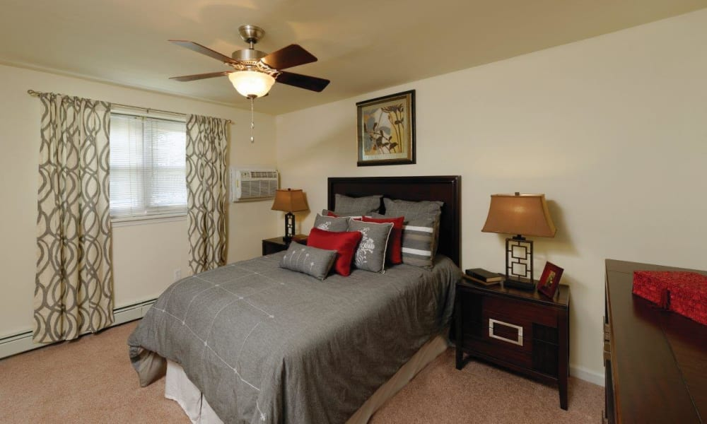 Bright bedroom at Hill Brook Place Apartments in Bensalem, Pennsylvania