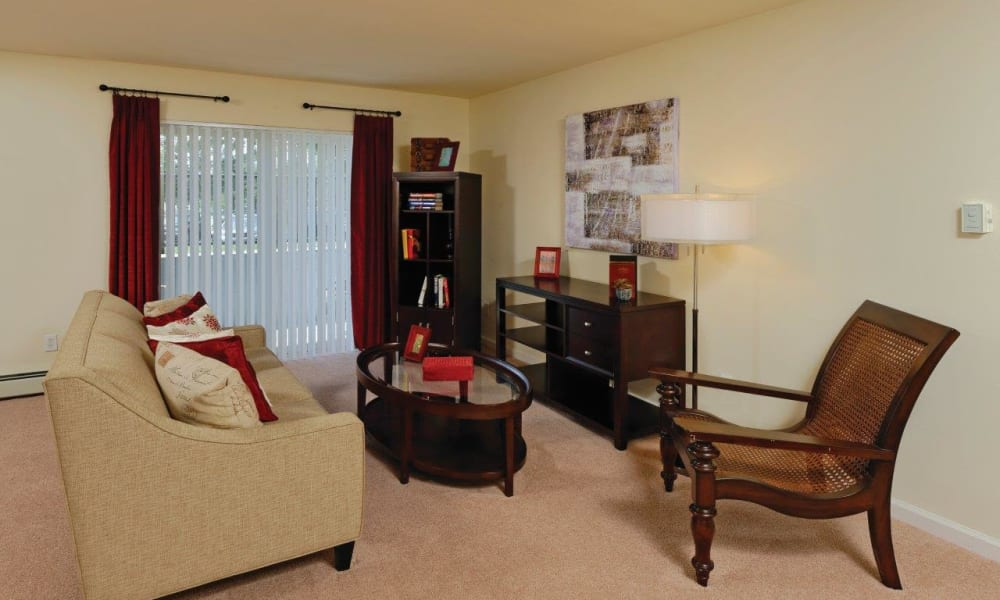 Well decorated living room at Hill Brook Place Apartments in Bensalem, Pennsylvania