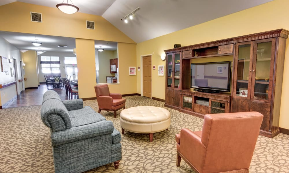 Cozy seating in front of a television at Rosewood Memory Care in Hillsboro, Oregon