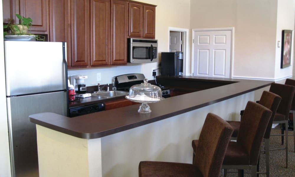 Kitchen with bar style seating at East Meadow Apartments in Fairfax, Virginia