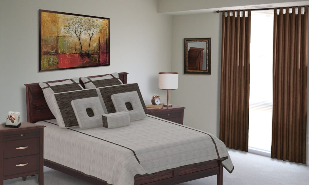Bright bedroom at East Meadow Apartments in Fairfax, Virginia