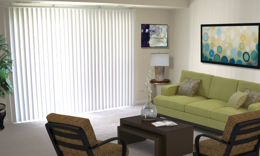 Living room with patio access at East Meadow Apartments in Fairfax, Virginia