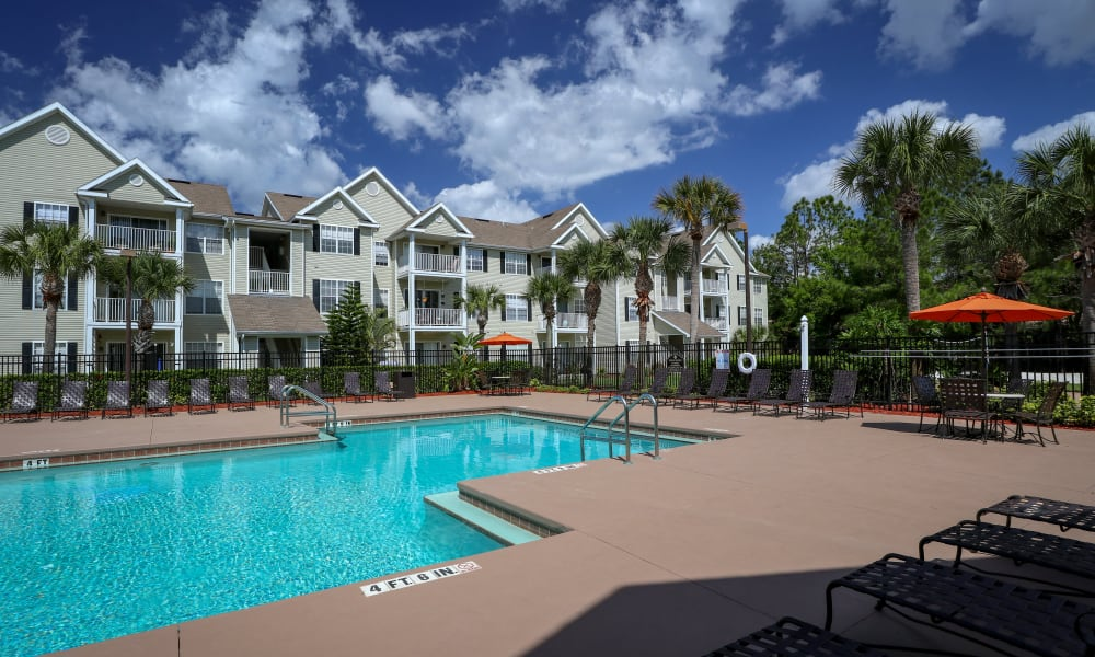 Relaxing pool area at Palms at Wyndtree Apartments