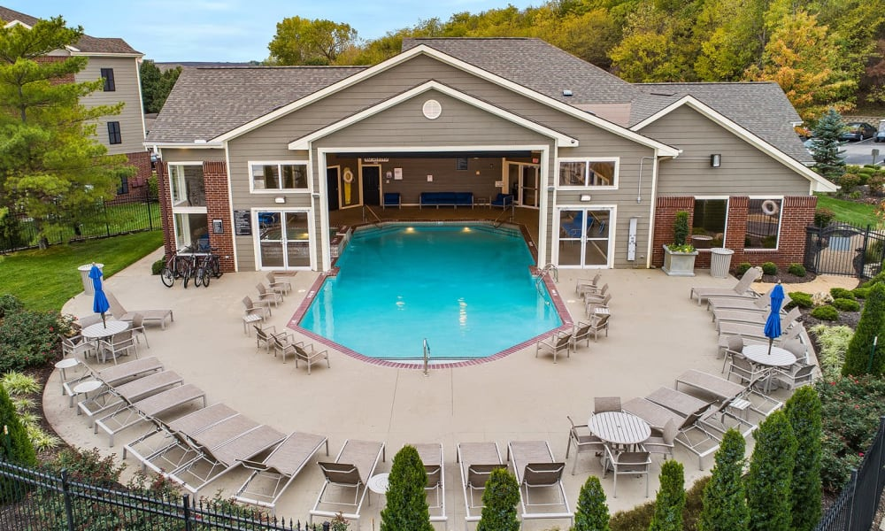 Resident pool with lounge chairs at Cornerstone Apartments in Independence, Missouri.
