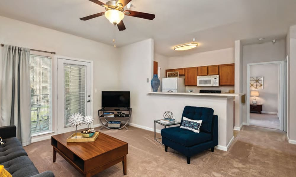 Spacious living rooms at Cornerstone Apartments in Independence, Missouri.