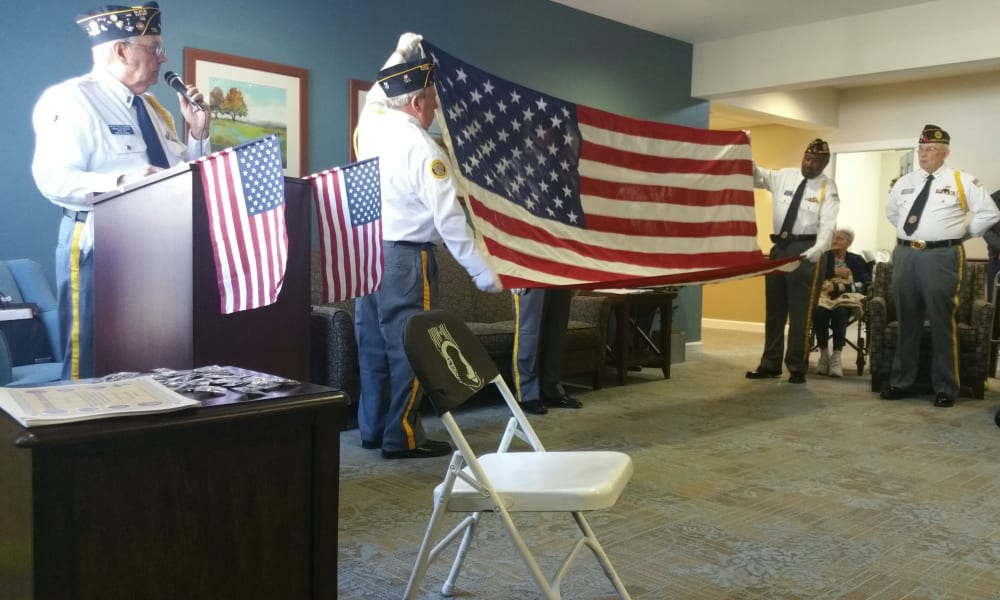 Veteran residents folding an American flag at Heritage Green Assisted Living in Mechanicsville, Virginia