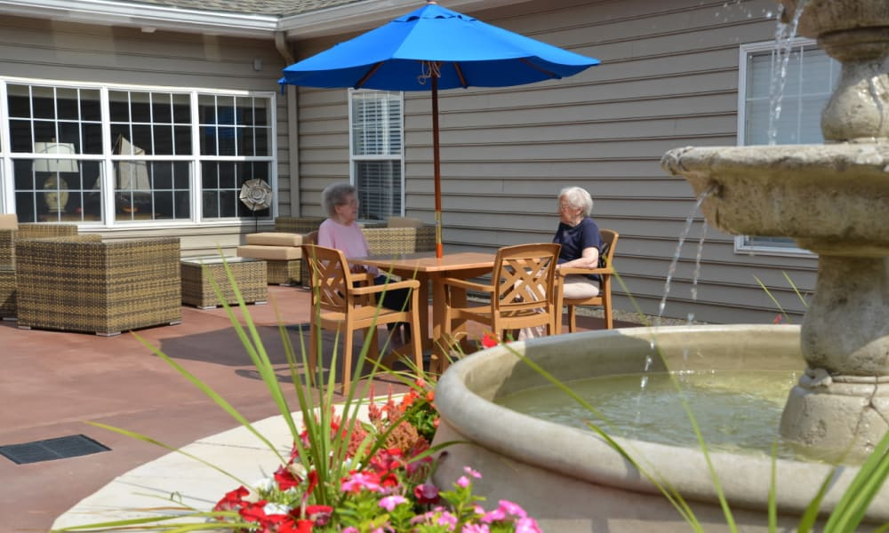 Covered seating on the patio at Heritage Green Assisted Living in Mechanicsville, Virginia