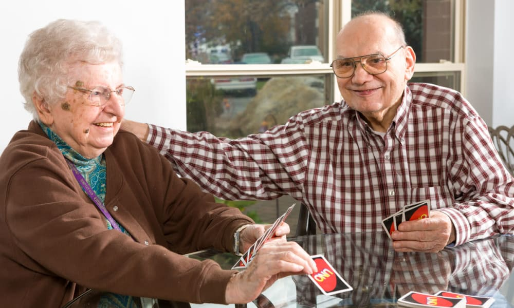 Residents playing cards at The Manor at Market Square in Reading, Pennsylvania