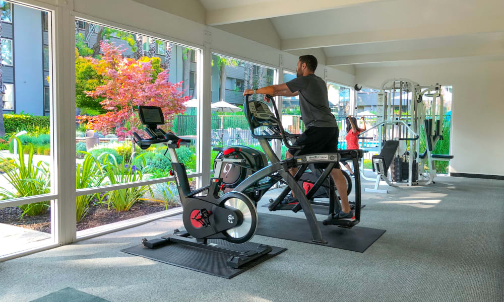 Resident working out at Palo Alto Plaza's gym in Mountain View, California