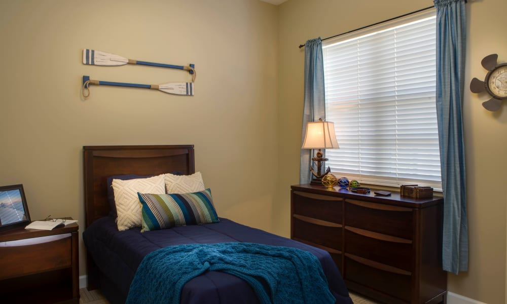 Marina themed bedroom at Beach House Assisted Living & Memory Care Naples in Naples, Florida