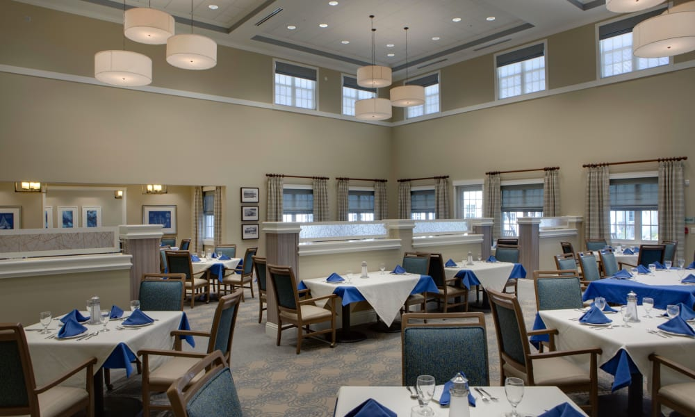 Carpeted dining hall at Beach House Assisted Living & Memory Care Naples in Naples, Florida