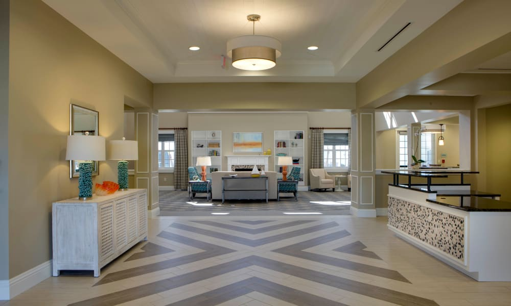Hallway leading to the atrium at Beach House Assisted Living & Memory Care Naples in Naples, Florida