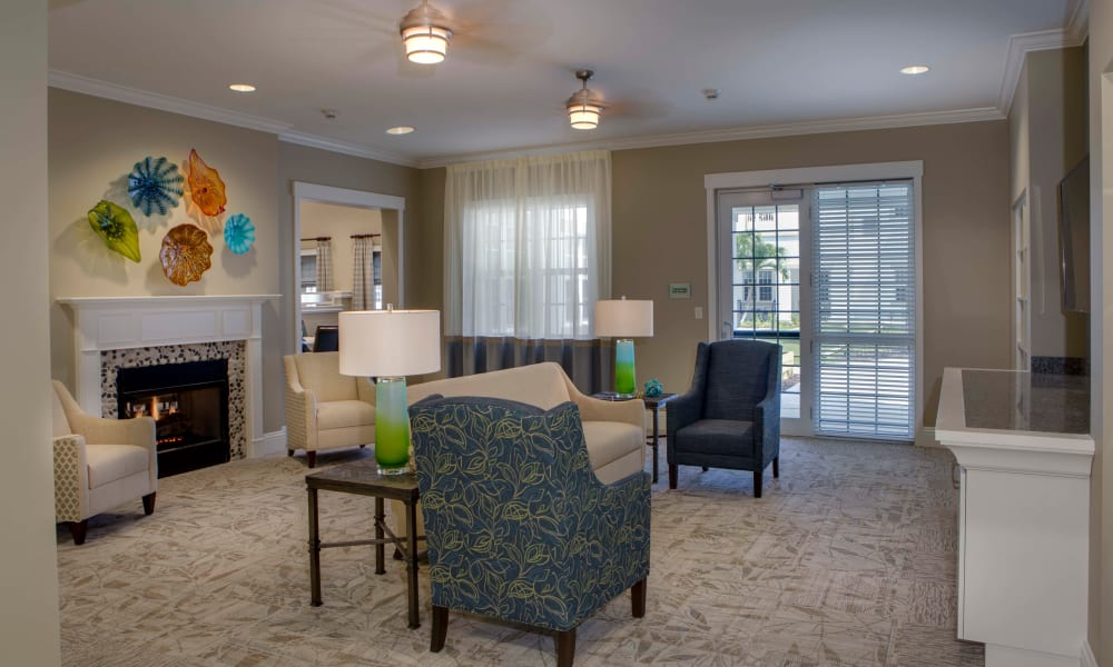 Fireplace lounge at Beach House Assisted Living & Memory Care Naples in Naples, Florida