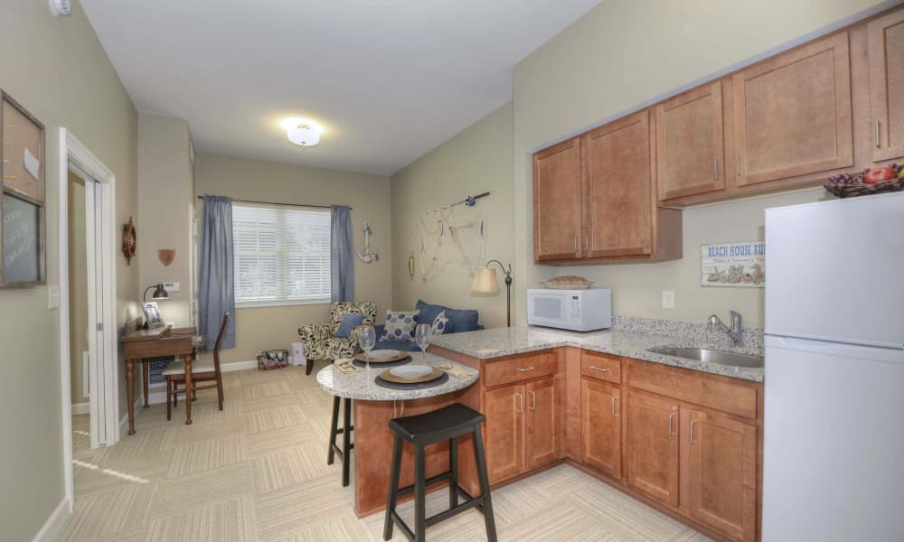 Spacious apartment kitchen at Beach House Assisted Living & Memory Care Naples in Naples, Florida