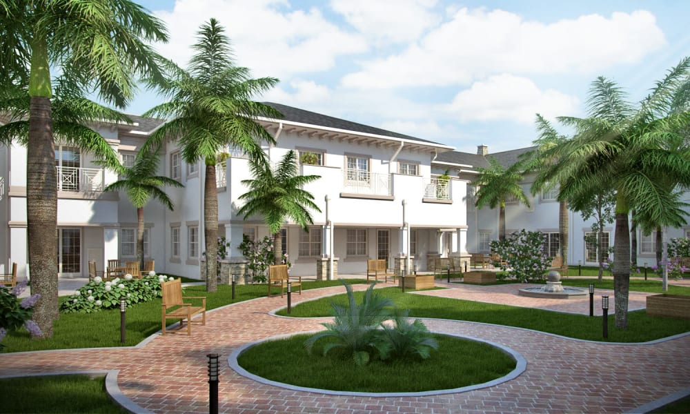Courtyard leading up to Beach House Assisted Living & Memory Care Naples in Naples, Florida