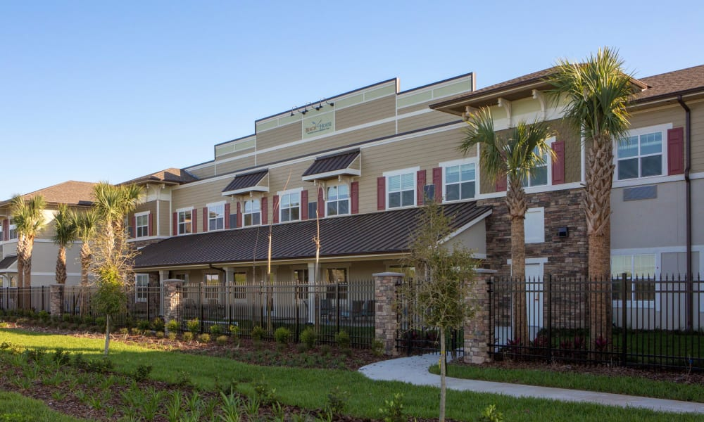 View of Beach House Assisted Living & Memory Care at Wiregrass Ranch from the front lawn in Wesley Chapel, Florida