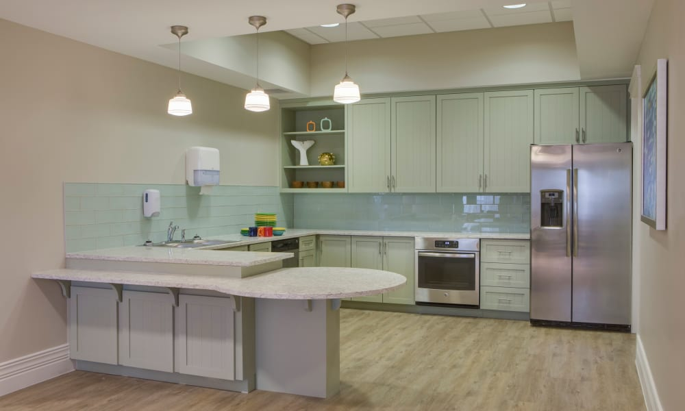 Community kitchen and breakfast bar at Beach House Assisted Living & Memory Care at Wiregrass Ranch in Wesley Chapel, Florida