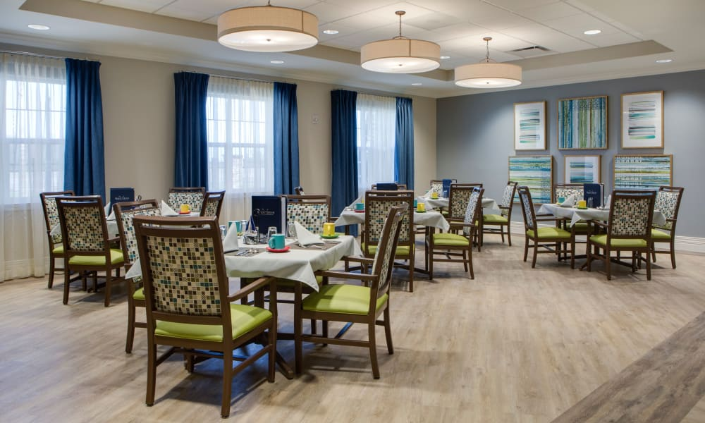 Dining hall with hardwood flooring at Beach House Assisted Living & Memory Care at Wiregrass Ranch in Wesley Chapel, Florida