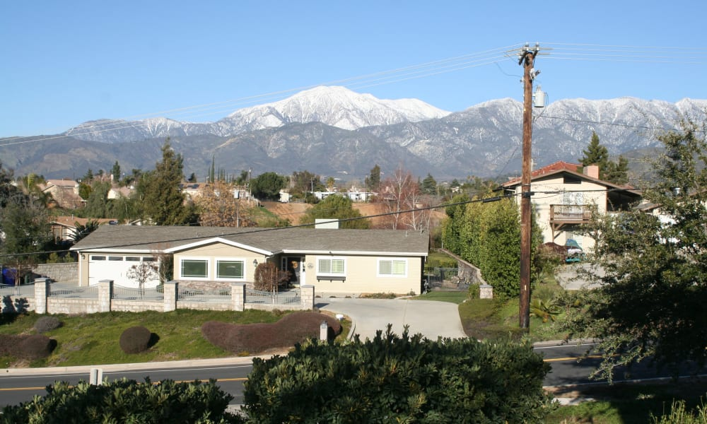 Exterior view with mountains at Wildwood Canyon Villa Assisted Living and Memory Care in Yucaipa, California