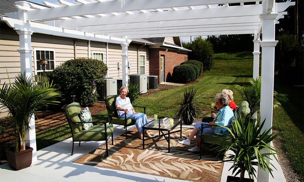 Covered outdoor seating at Heritage Green Assisted Living and Memory Care in Lynchburg, Virginia