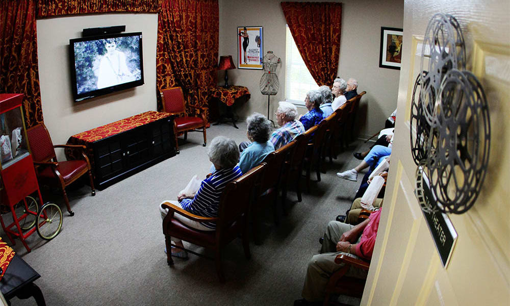 Residents in the community movie theater at Heritage Green Assisted Living and Memory Care in Lynchburg, Virginia