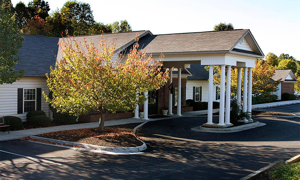 Building exterior and main entrance at Heritage Green Assisted Living and Memory Care in Lynchburg, Virginia