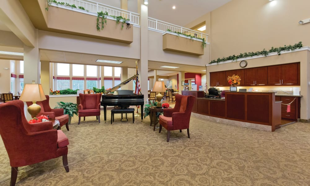 Clubhouse lobby with a grand piano at Heron Pointe Senior Living in Monmouth, Oregon