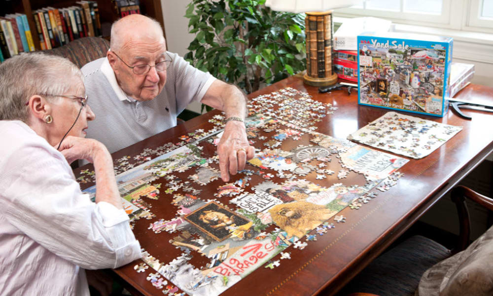 Residents solving a puzzle at Senior Commons at Powder Mill in York, Pennsylvania