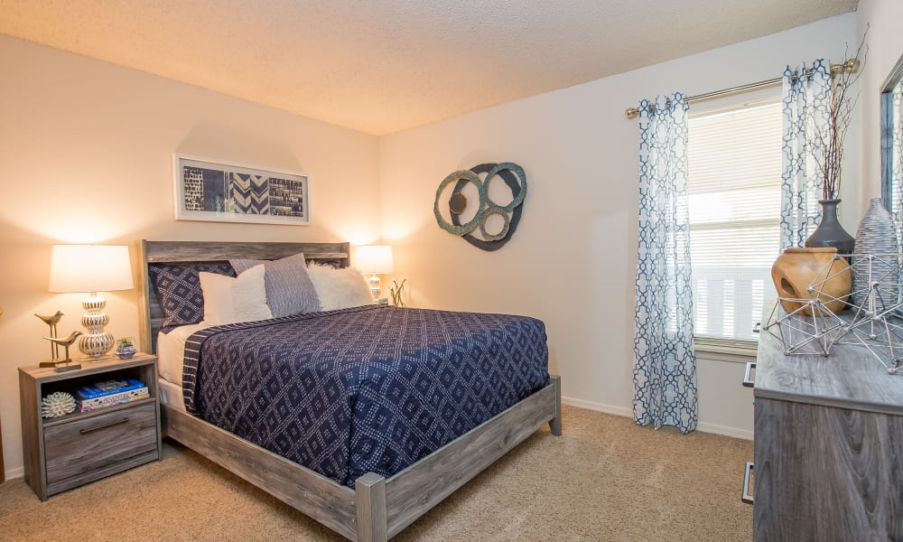 An apartment bedroom at Sunchase Ridgeland Apartments in Ridgeland, MS