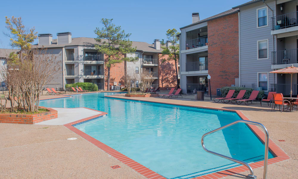 A community pool at Woodscape Apartments in Oklahoma City, OK