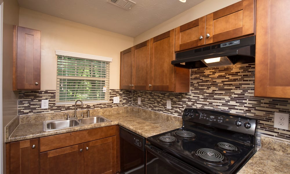 Kitchen with custom wood cabinets at The Crossing at Henderson Mill in Atlanta, Georgia