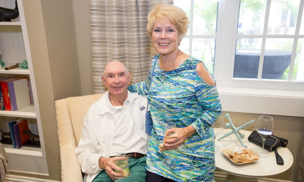 Senior couple having beverages together at Beach House Assisted Living & Memory Care Naples in Naples, Florida