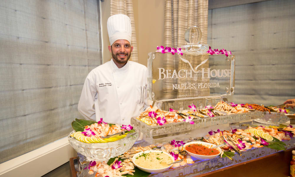Chef at banquet table at Beach House Assisted Living & Memory Care Naples in Naples, Florida