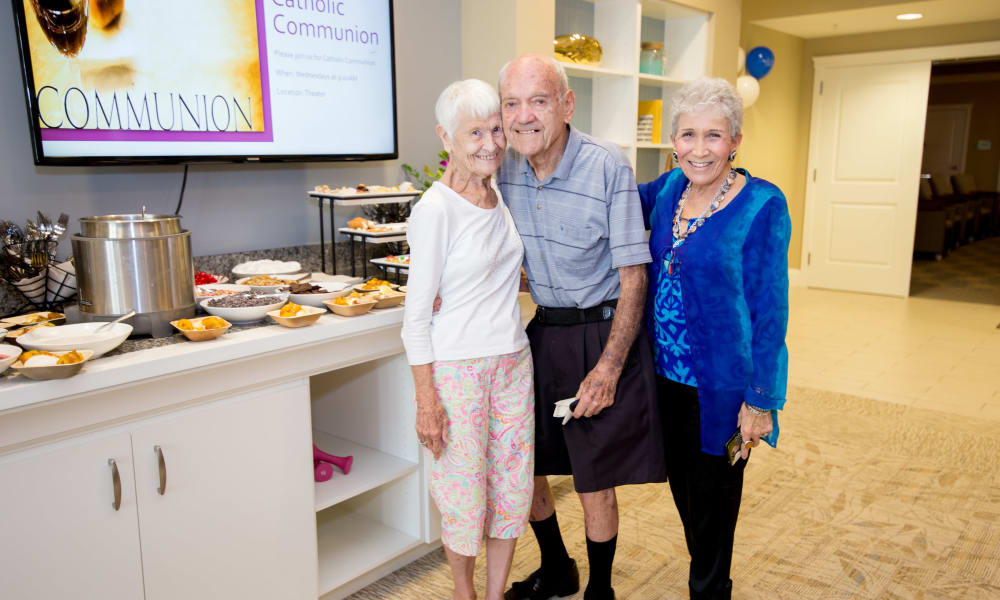 Three seniors enjoying a social activity at Beach House Assisted Living & Memory Care Naples in Naples, Florida