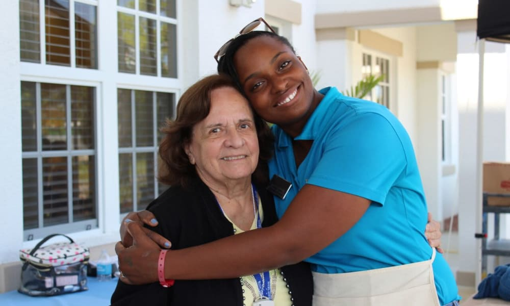 Staff member and resident at Beach House Assisted Living & Memory Care Naples in Naples, Florida