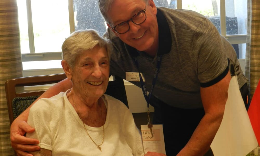 Smiling senior couple at Beach House Assisted Living & Memory Care Naples in Naples, Florida